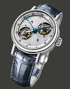 Breguet double tourbillon in platinum. The dial makes a rotation every twelve hours, the bridge connecting the tourbillons is the hour hand!