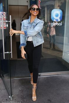 Chic:The former Mis-Teeq star, 39, showed off her slender figure in a pair of high-waisted black skinny jeans and a white vest top - Alesha Dixon.