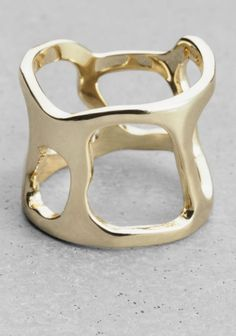 & OTHER STORIES Crafted from brass, this ring has differently shaped cutout details.