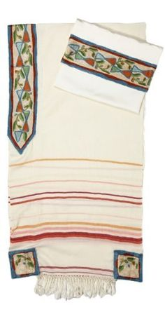 White Wool Tallit with Green, Red and Blue Stars of David and Red Stripes by World of Judaica. $146.00. This white wool Tallit features blue, green and red Stars of David and a floral pattern on the Atara and has yellow, pink and red stripes on the sides. This white wool Tallit features a vibrant blue, green and red Star of David pattern on a pale yellow background and is edged with a blue and red border. The Tallit is also decorated with a floral pattern on the Star...
