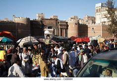 Activity at the market outside the 1,000-year old Bab Al-Yemen (the Gate of Yemen) at the centre of the old town of Sana'a - Stock Image