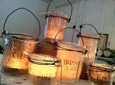 Old Jelly Jar Lights...stamped & punched kraft paper inside with wire & butcher's string outside & a battery operated tea light...so prim.