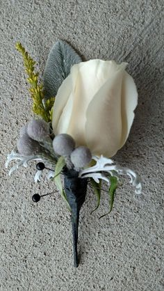 Groom's Boutonniere with Vendella rose, silver brunia, dusty miller, lamb's ear and a sprig of solidago. #YellowGrayCreamWedding