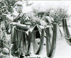 picsofhistory101 paratrooper hanging ammunition for M60 machine gun, presumably to keep it clean and dry