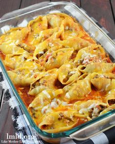 Mexican Stuffed Shells – filled with a ground beef and cream cheese mixture, cooked in a bath of enchilada sauce and salsa topped with cheddar cheese.