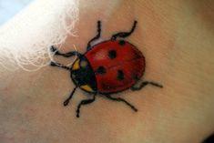 Ladybug Tattoos | Yellow Eyes Ladybug Tattoo On Neck