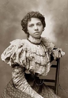 Unique photograph of African American woman, wearing a costume dating to 1895-1900's. Usually African American's were not able to wear pretty garments as this is.   http://www.griphop.com/