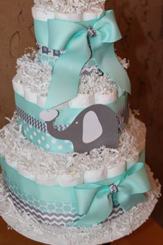 Elephant Theme Diaper Cake! This cake is mint green, gray chevron and white, accented with 3 elephants made out of high quality cardstock!