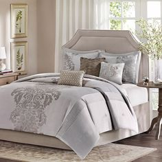 Refresh your master suite or guest room with this lovely comforter set, showcasing a damask motif for eye-catching appeal.    Product: ...