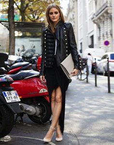 An edgy military jacket balances out the ladylike heels and slit-up-to-there skirt.