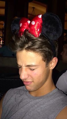 Cameron Dallas wearing Minnie Mouse ears. How cute