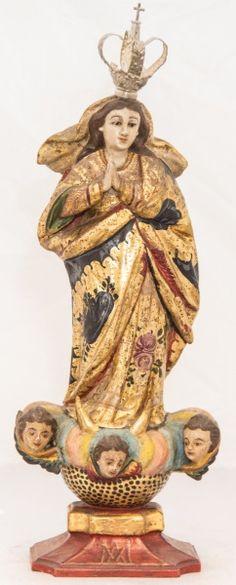 Imagem de Nossa Senhora da Conceição, madeira policromada. Bahia, século XIX. Alt. 32cm. Vendida 2.000,00