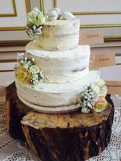 Saunts three tiered half naked wedding cake! Chocolate,Lemon and almond.