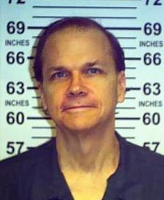 This June 1, 2013 photo provided by the New York State Department of Corrections shows Mark David Chapman at the Wende Correctional Facility..!!! GOOD to know that this guy is still in prison, and denied parole. He says, that he shouldn't have acted like an idiot! REALLY? How about he shouldn't have MURDERED an INNOCENT UNARMED man. A famous man that thrilled the world with his GREAT music! How about that YOU CRAZY IDIOT? !!!