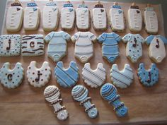 Vanilla sugar cookies & chocolate chip roll-out cookies for a baby shower for 2 baby boys, using a modified royal icing recipe.