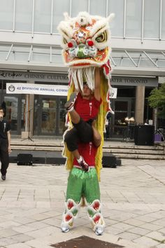 Lion jumping up in the air Lion Dance, Toronto, Harajuku