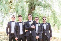 Classic formal groom + groomsmen outfit idea - classic black tux + black bowtie with groomsmen posing wearing sunglasses {Julie Bulanov Photography}