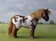 """Paint"" horse, previously known as pinto. He also has blue eyes."