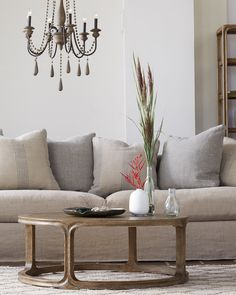 Spanning the style spectrum - Our versatile Bertogne Collection features hand-carved solid oak surfaces that are hand-rubbed with a beautiful chestnut stain for a rich, luxurious color. #coastalstyle #homedecor #livingroom #inspiration #interiordesign #refresh #coffeetable