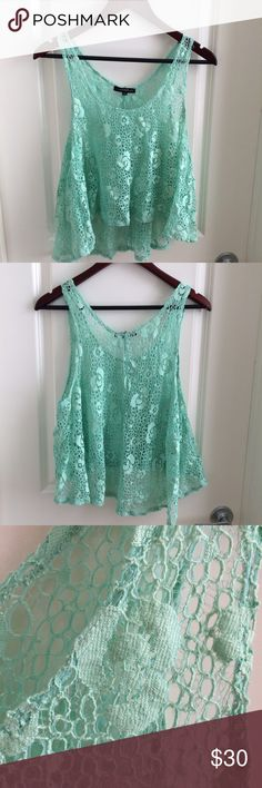 ANGL Lace Tank Beautiful seafoam green lace overlay top from ANGL ! Worn layered or a great coverup over a bikini ! Excellent condition, worn once ! Stone Cold Fox Tops Tank Tops