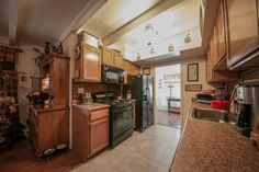 Kitchen with all appliances included!  Tile flooring is new.