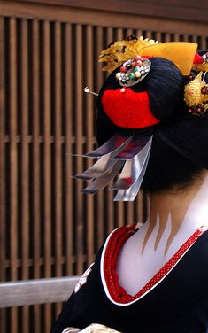 geisha--they always wore the back neckline as low as possible---kinda like an advertisement.  supposed to be super super sexy to reveal that neck in Japan.  Oh and those flip flops on 5 inch blocks---well the sewers have a tendency to over flow in the rainy season!  eeewwwww.