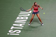 Maria Sharapova of Russia returns a shot to Sara Errani of Italy in round robin play during the TEB BNP Paribas WTA Championships