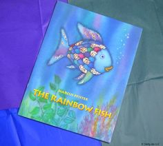 It's time for a Skilly-do Book Review! The Rainbow Fish - the award winning book By Marcus Pfister, http://amzn.to/2oXHOee for children ages 1 to 5 years old, tells a story about sharing, friendship and the most beautiful fish in the ocean. When the Rainbow Fish refuses to give away one of his shining scales, he begins a life changing journey. The big book version-- measuring 1 foot wide and 1-½ feet tall-- will immerse young readers with its fine details and glittering, silvery fish scales…