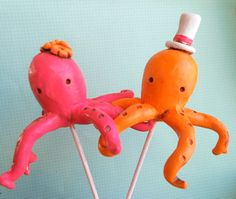 The cake topper, but picture the octopuses in shades of Aqua. The groom will wear a yamaka instead of a hat, and the bride will have a white orchid instead of 3 generic flowers. Too cute!