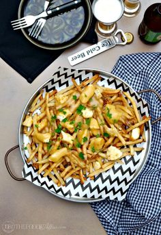 French-Canadian poutine recipe is made of French fries, cheese curds and light brown gravy! Simple appetizer or side dish when you use pre-made fries! Poutine Recipe, Fries Recipe, Canadian Poutine, Gravy Fries, Cheese Curds, Healthy Vegan Snacks, Fries In The Oven, Easy Food To Make, Appetizer Recipes