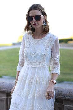 Wavy bob, lace embroidered dress and statement crystal earrings