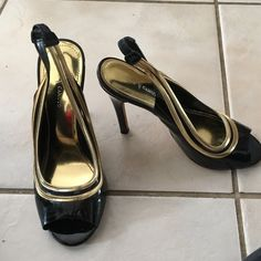 Vince Camuto heels in size 8 Black with gold trim peep toe heels. Vince Camuto Shoes Heels