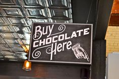 Buy Chocolate Here sign at Videri Chocolate Factory