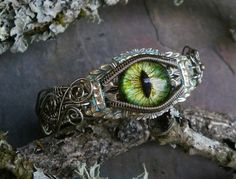 My favorite artist for the evil eye jewelry.   Gothic Steampunk Bracelet Evil Cat Eye 6 to 7 by twistedsisterarts, $89.95