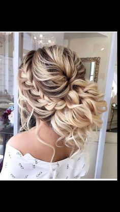 Loose curly updo.