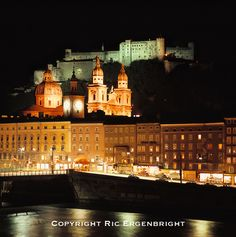 Lights reflect in the Salzlach River below the Dom and the Hohensalzburg in Salzburg, Austria. ©Ric Ergenbright