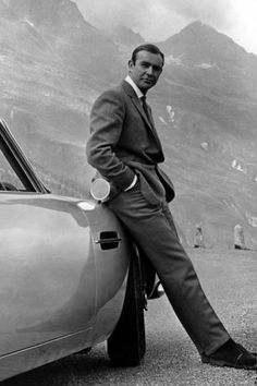 Sean Connery as James Bond and his Aston Martin DB5 whilst filming Goldfinger, 1964.