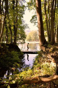 Boy on a wooden bridge, Jajce