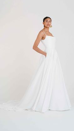 Meet Jenny Yoo's Thalia gown for Fall 2020. Let out your inner socialite in the Thalia, who's soft Mikado and ballgown skirt were made forwaltzing around the dance floor. Featuring a scoop neckline, Open back long Chapel train skirt. This stunning & chic wedding dress is perfect for a Spring, Fall or Winter wedding! Chic Wedding Dresses, Most Beautiful Wedding Dresses, Little Black Books, Gowns With Sleeves, Chapel Train, White Satin, Wedding Bells, One Shoulder Wedding Dress, Ball Gowns