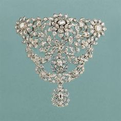 An 18th century rose-cut diamond stomacher  In the form of a closed-set table and rose-cut diamond floral spray panel suspending twin cluster drops with supporting diamond cluster swags, in silver-gilt mount, circa 1780, probably Portuguese, later added loops for wear as a slide