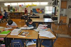 Upper elementary students using Montessori materials in the classroom