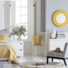 Yellow and Gray bedroom I like the round mirror!