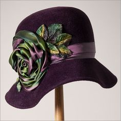 Andrea IX cloche design by Louise Green in aubergine velour with autumn ribbon rose and velvet leaves
