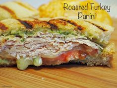 This roasted turkey panini recipe features arugula pesto mayo along with smoked mozzarella and roma tomatoes all presented on crispy sour dough bread.