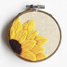 A hand embroidered sunflower hoop to bring a little sunshine into any space! 3 hoop with 100% cotton thread Comes with a bronzed copper chain __________________________________________ Due to the cost of tracked shipping with Canada Post, All hoops will be shipped without