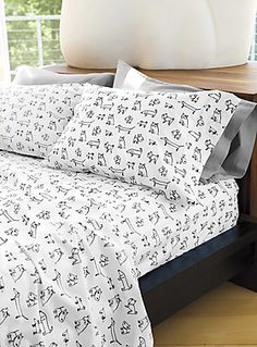 My dream home would have dachshund stuff all over, just like this amazing wiener dog bed set!