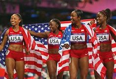 Carmelita Jeter, Bianca Knight, Allyson Felix & Tianna Madison of the United States celebrate after winning gold & setting a new world record of 40.82