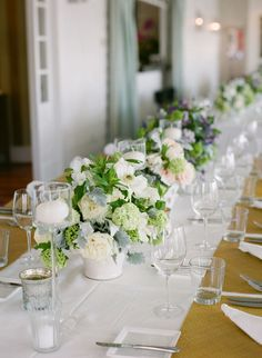 Lovely pale flowers line this table. Photo by Meg Runion Studios