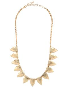 A simple strand of tab-shaped pendants have a decidedly utilitarian feel in an unexpected brushed gold finish.  This easy to layer piece is a little bit statement and a little bit classic – no matter how you style it, this will be the piece you reach for again and again.  This is part of the BaubleBar + Atlantic-Pacific Collection