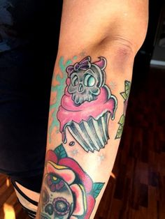 New School Skull Cupcake by Dave Smiley Tattoos. Click to get more food tattoo inspiration.